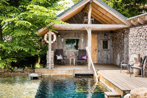 Outdoor Finnish sauna with salty plunge pool